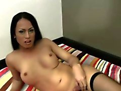 Long haired tranny strokes cock while giving blowjob in POV