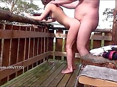 The Beast takes care of her small girl on balcony at the cabin