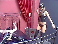 Femdom dominatrix spank and turture hard belly of slave
