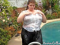 Huge babe goes swimming fully clothed
