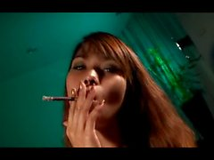Piss: Asian shemale smoking & pissing