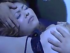 Sultry Asian lady has two masked guys kissing and caressing