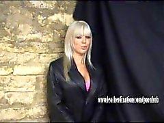 Horny babe talks dirty and masturbates on leather trench coat