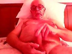 cam üzerinde Yaşlı adam jerkin ve kimyon