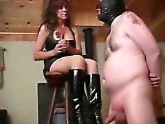 Brunette extreme femdom tortures her poor slaves balls