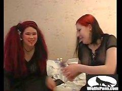 Two gothic lesbians in BDSM bondage video