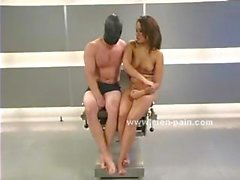 Asian mistress in slutty dress dominating man with leather helmet and tied in leather fucking him