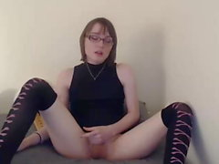 Very beautiful trap with glasses spanking cumming tiny cock