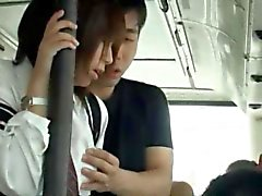 Slutty Asian babe gives head in a public bus