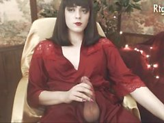 Pretty tgirl in red dress strokes & cums