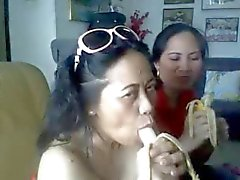 thai mature lady showing her big boobs and sucking banana