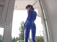 girl in blue latex teasing
