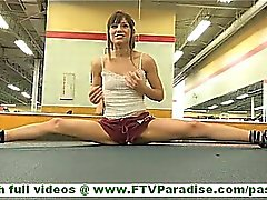 Risi sporty brunette teen flashing and stroking pussy in gym
