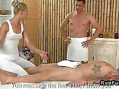 Oiled blonde masseuse banged by her customers