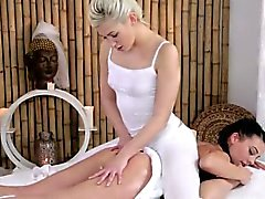 Lesbian masseuse tribbing with customer on a table