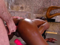 Toying ebony babe guzzles