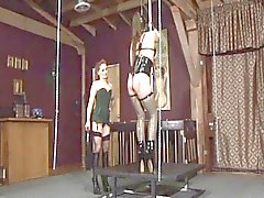 Sexy dominatrix tortures a sexy brunette with big titts