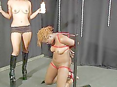 Ebony handled by a bondage queen