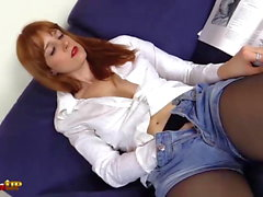 Redhead takes a shower and masturbates wearing black pantyho