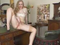 Horny office blonde Satine Spark wanks hairy muff on desk in open bra nylons and stilettos