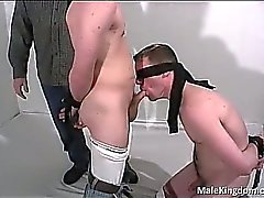 Tied homo is wanked off by filthy queer and
