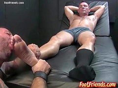 Franco strokes his cock on Russ feet and gives him a blowjob